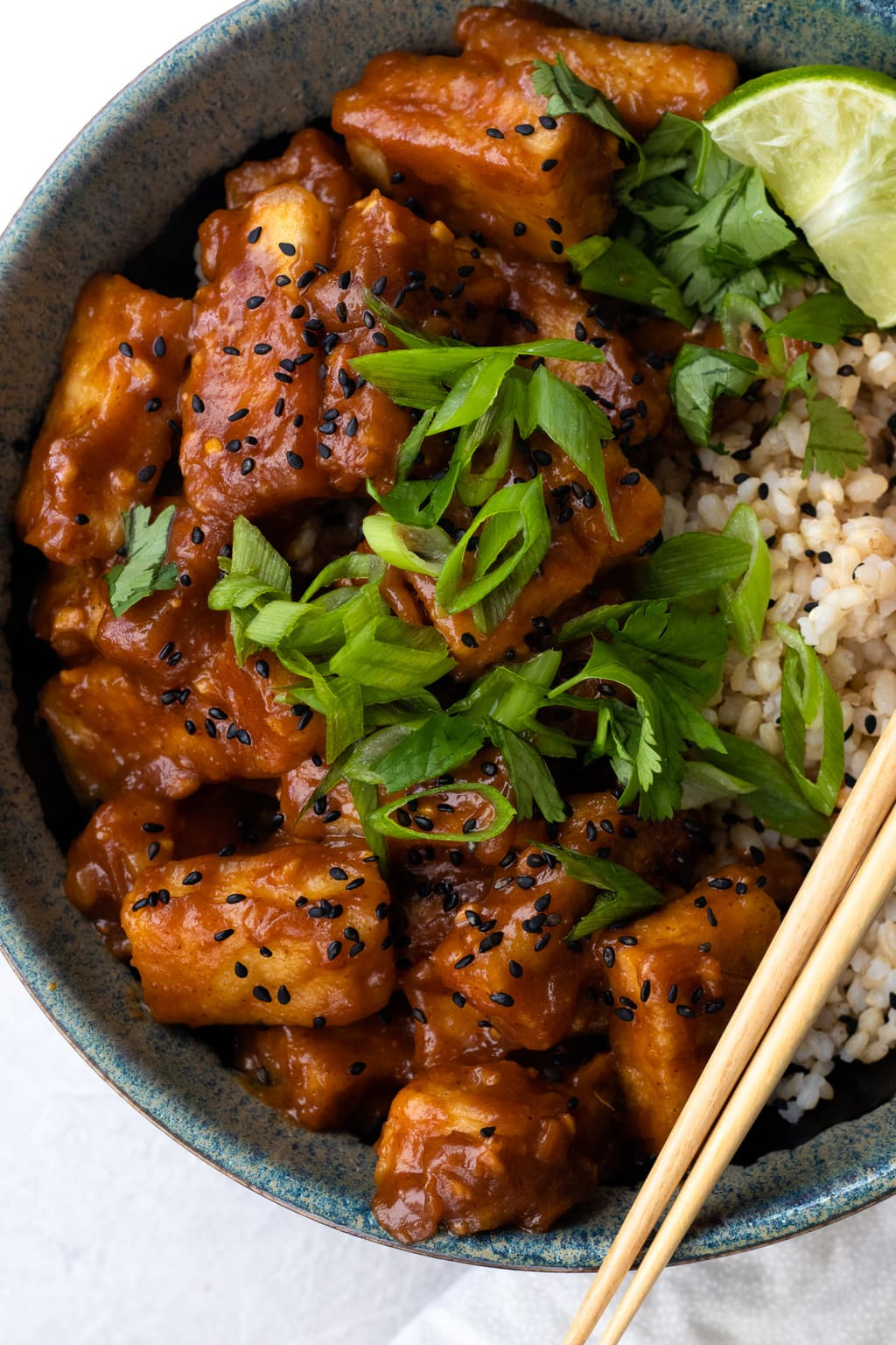 30 minute peanut sauce tofu with rice, green onion and chopsticks