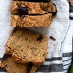 vegan zucchini bread sliced from overhead view on linen textured towel