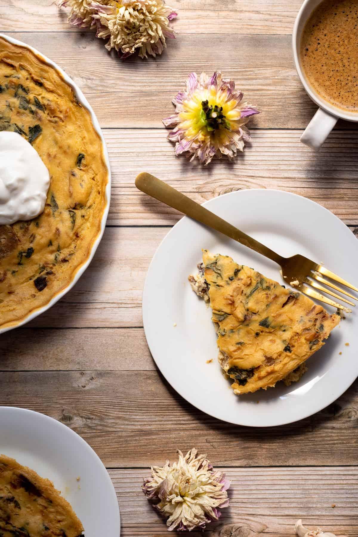 slices of vegan crustless quiche on white plates