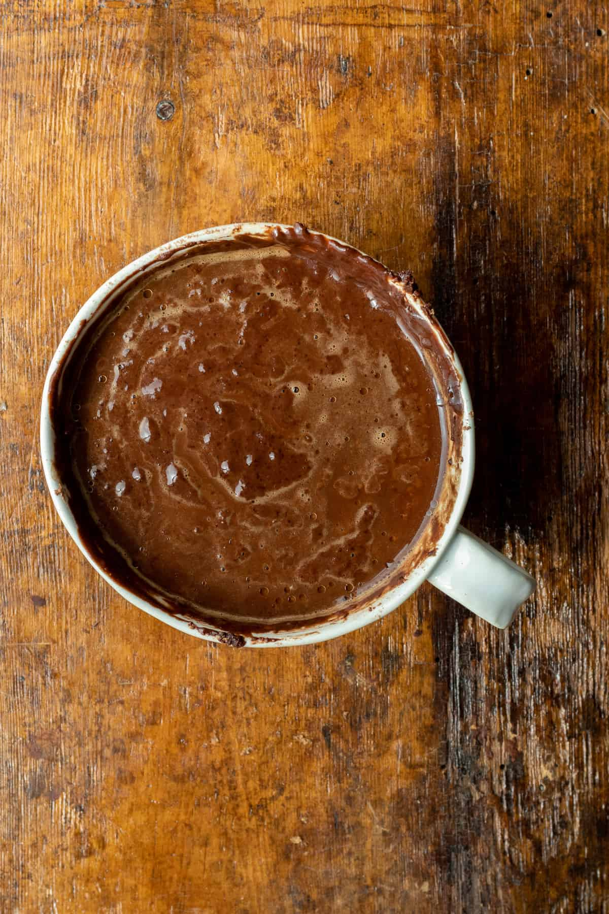Chocolate Mug cake batter in white mug