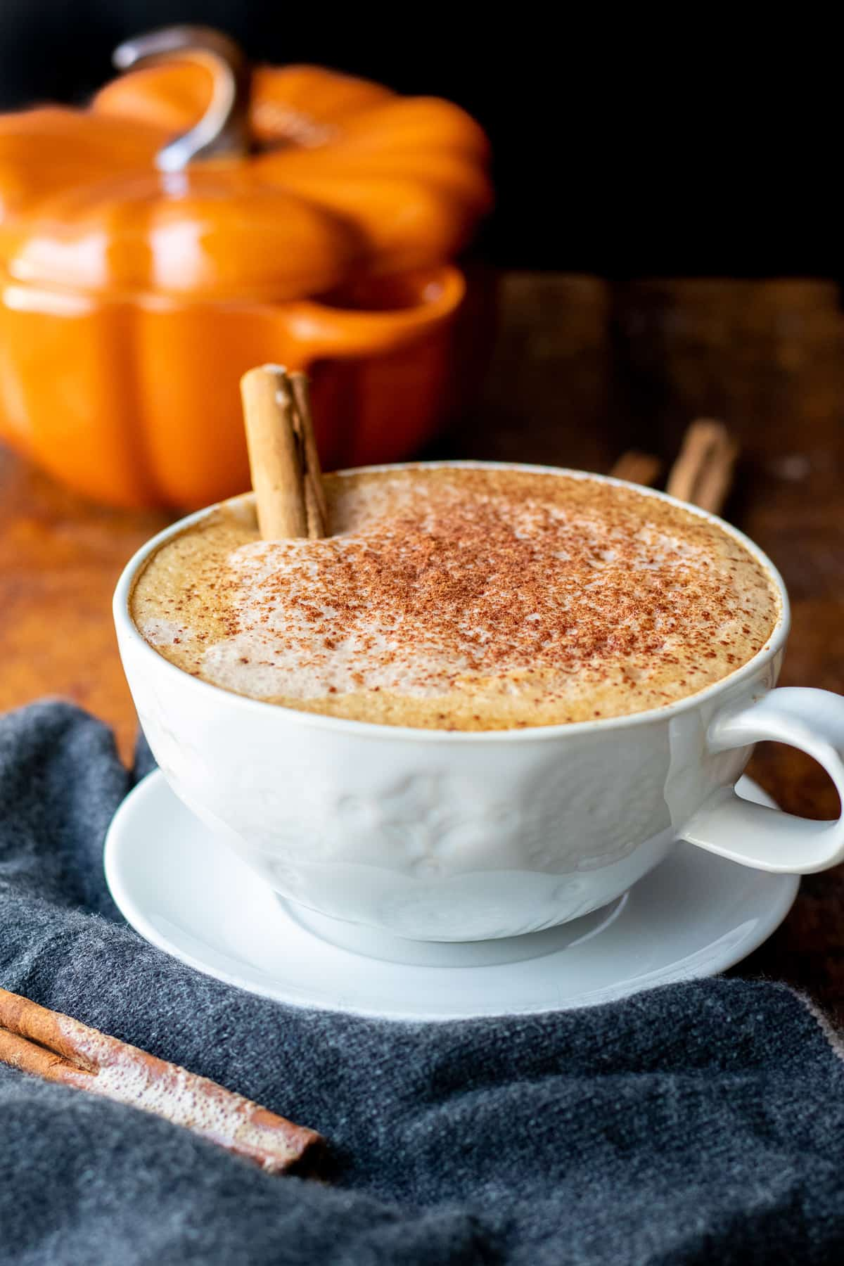 latte dusted with pumpkin pie spice in a white mug