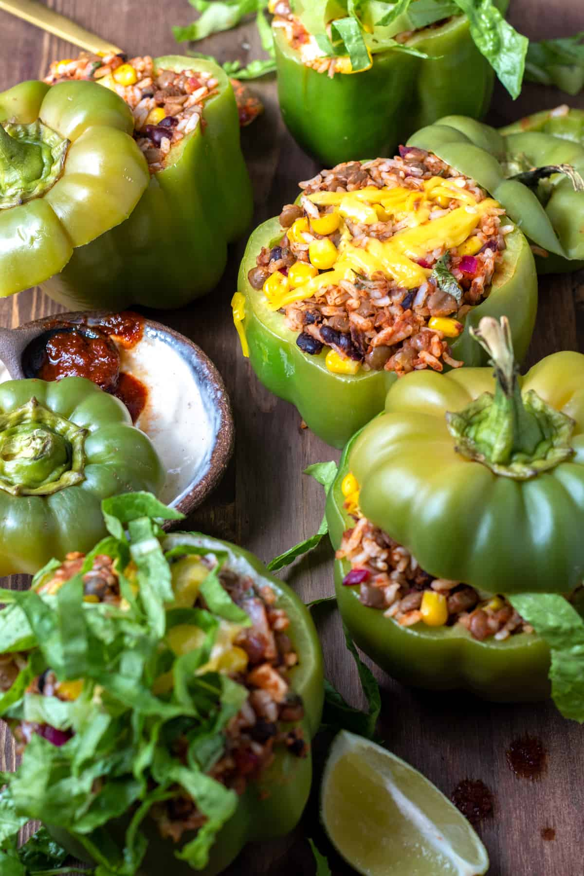 stuffed bell peppers topped with melted vegan cheese and cashew sour cream sauce