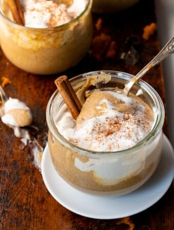 Pudding in glass jar with cinnamon stick