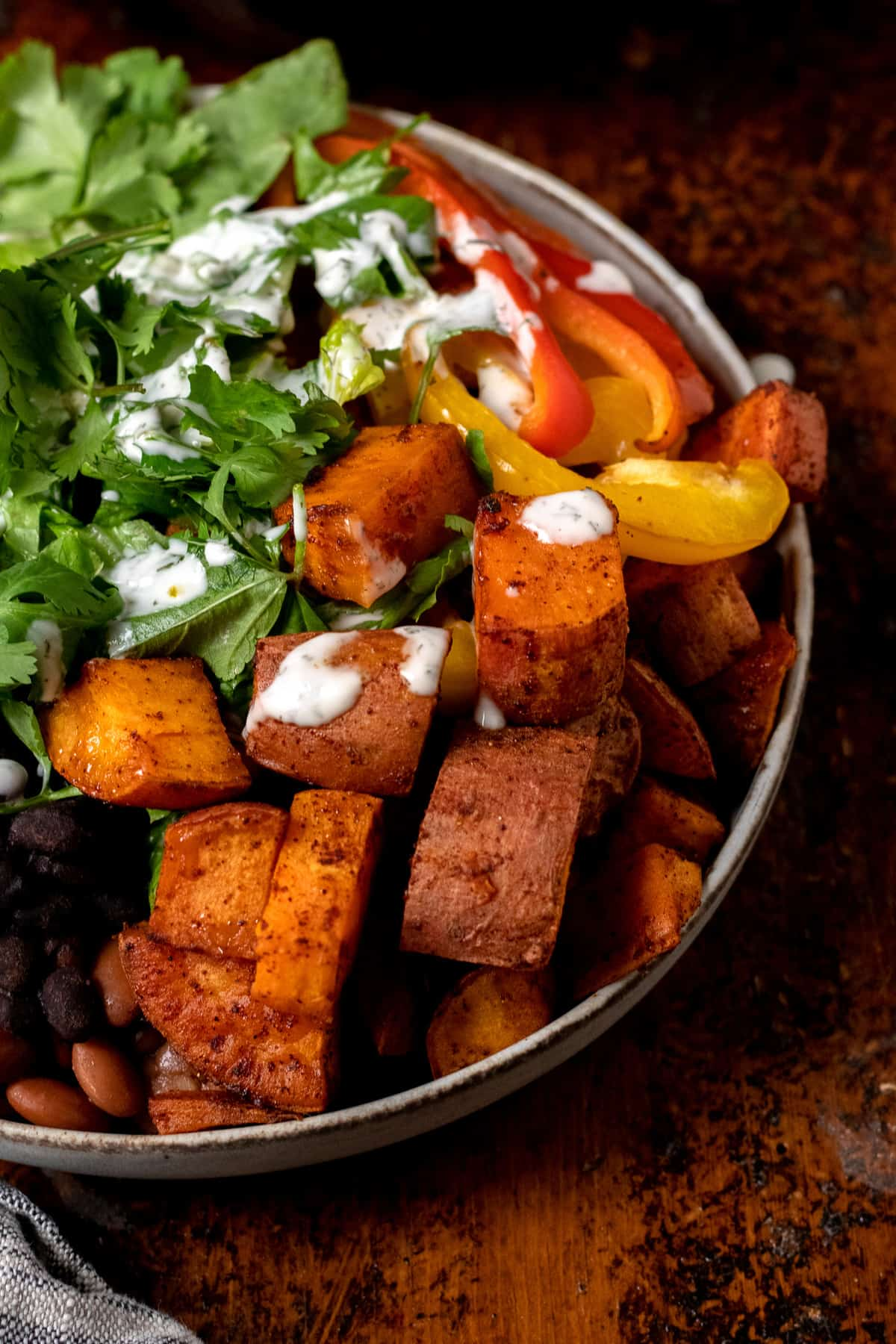 close up of burrito bowl with roasted sweet potato