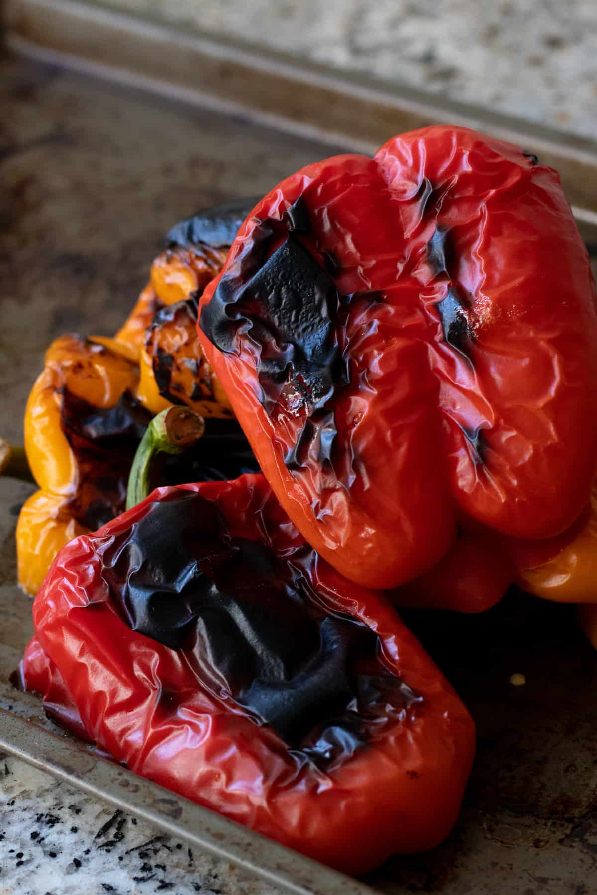 Roasted Red Peppers with Charred Skin on Baking Sheet