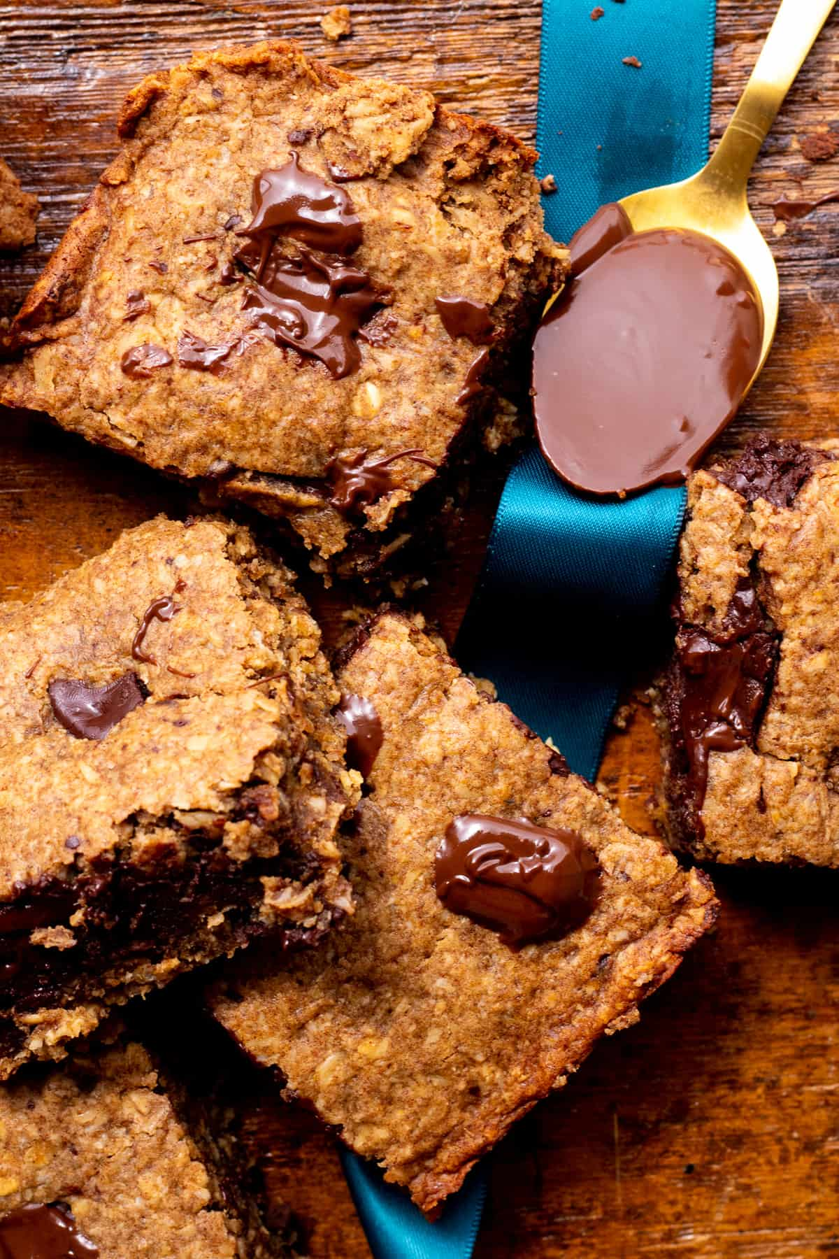 cookie bars close up with spoon of melted chocolate