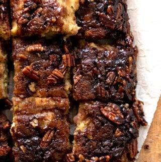 vegan apple cake cut into squares on parchment paper