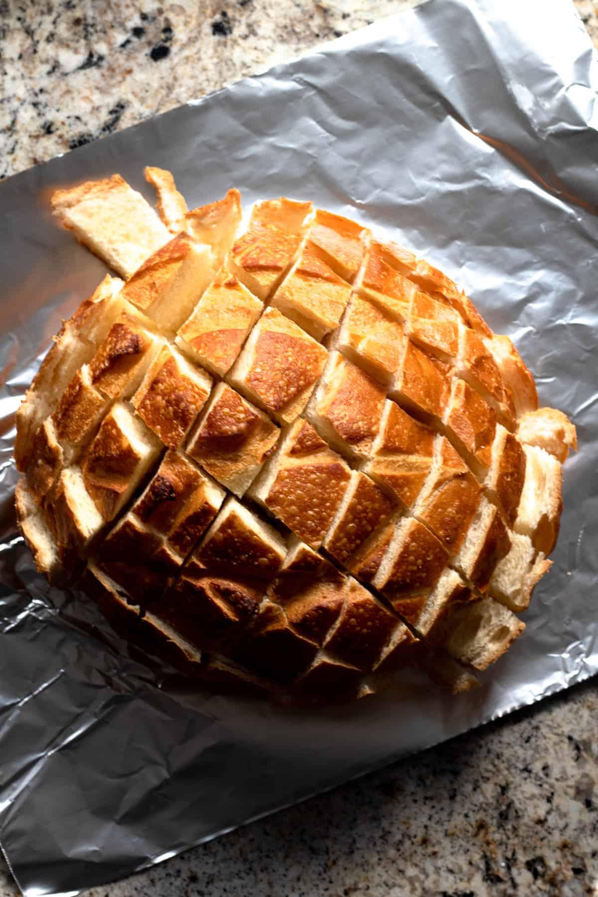 Vegan Sourdough Loaf on Tin Foil Sliced into InTact Cubes