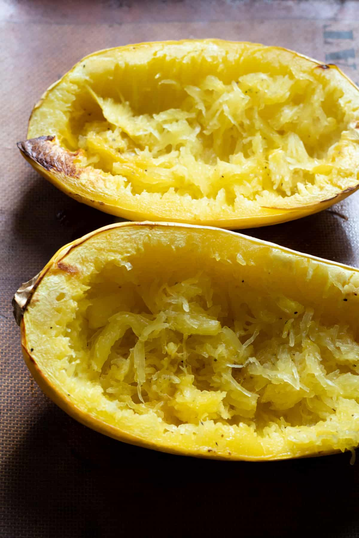 Spaghetti squash after baking with strands pulled.