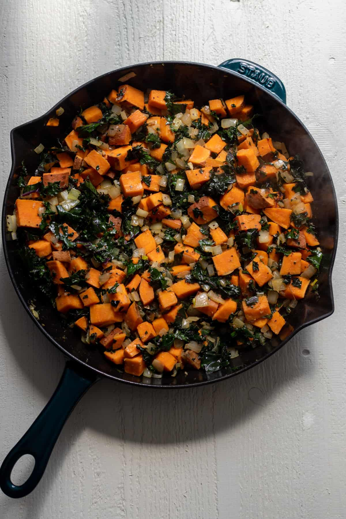 Kale tossed with sweet potato.