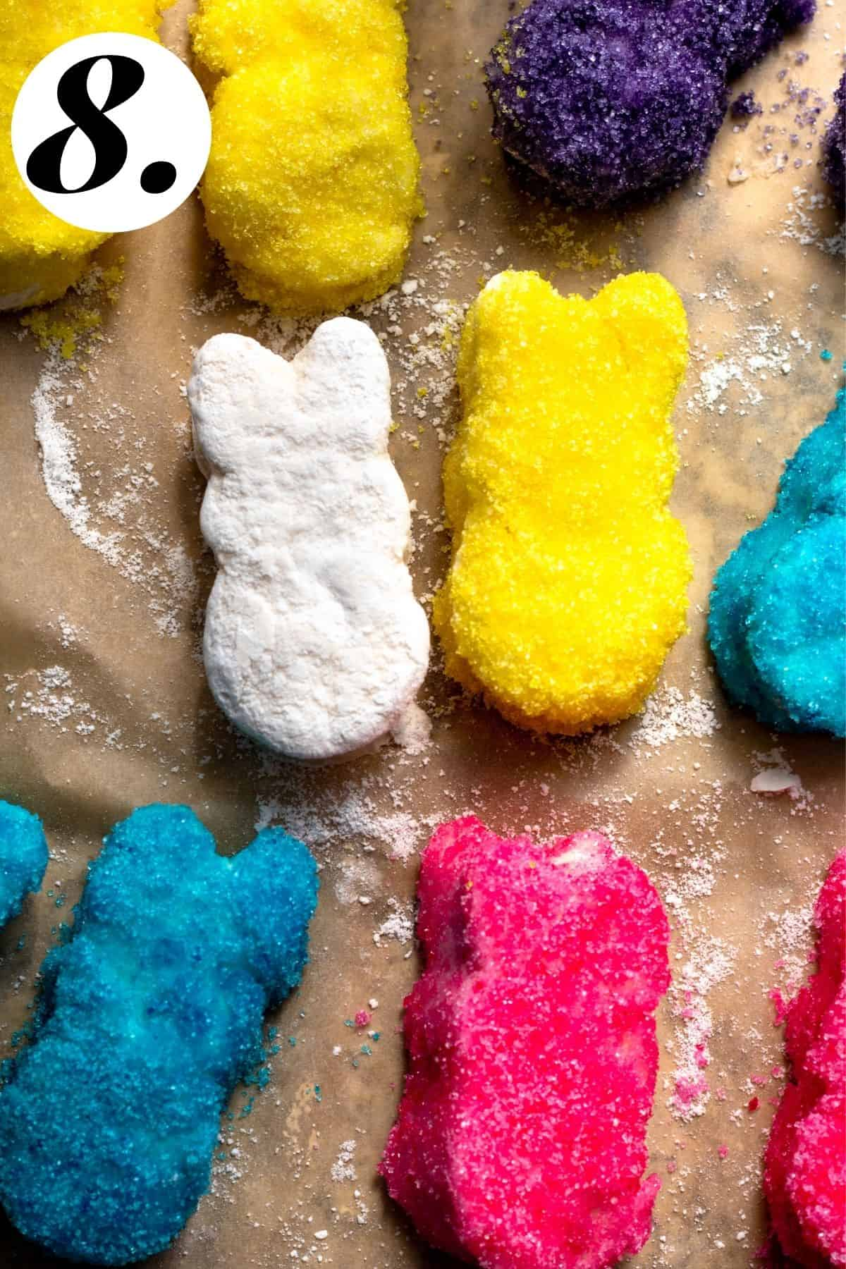 Sugared bunny marshmallows on parchment paper.