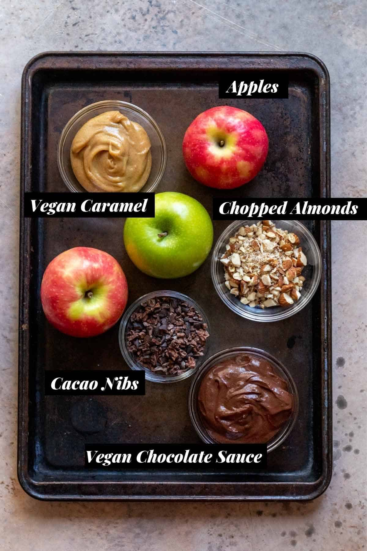 Ingredients measured into individual glass bowls and labeled on cookie sheet.