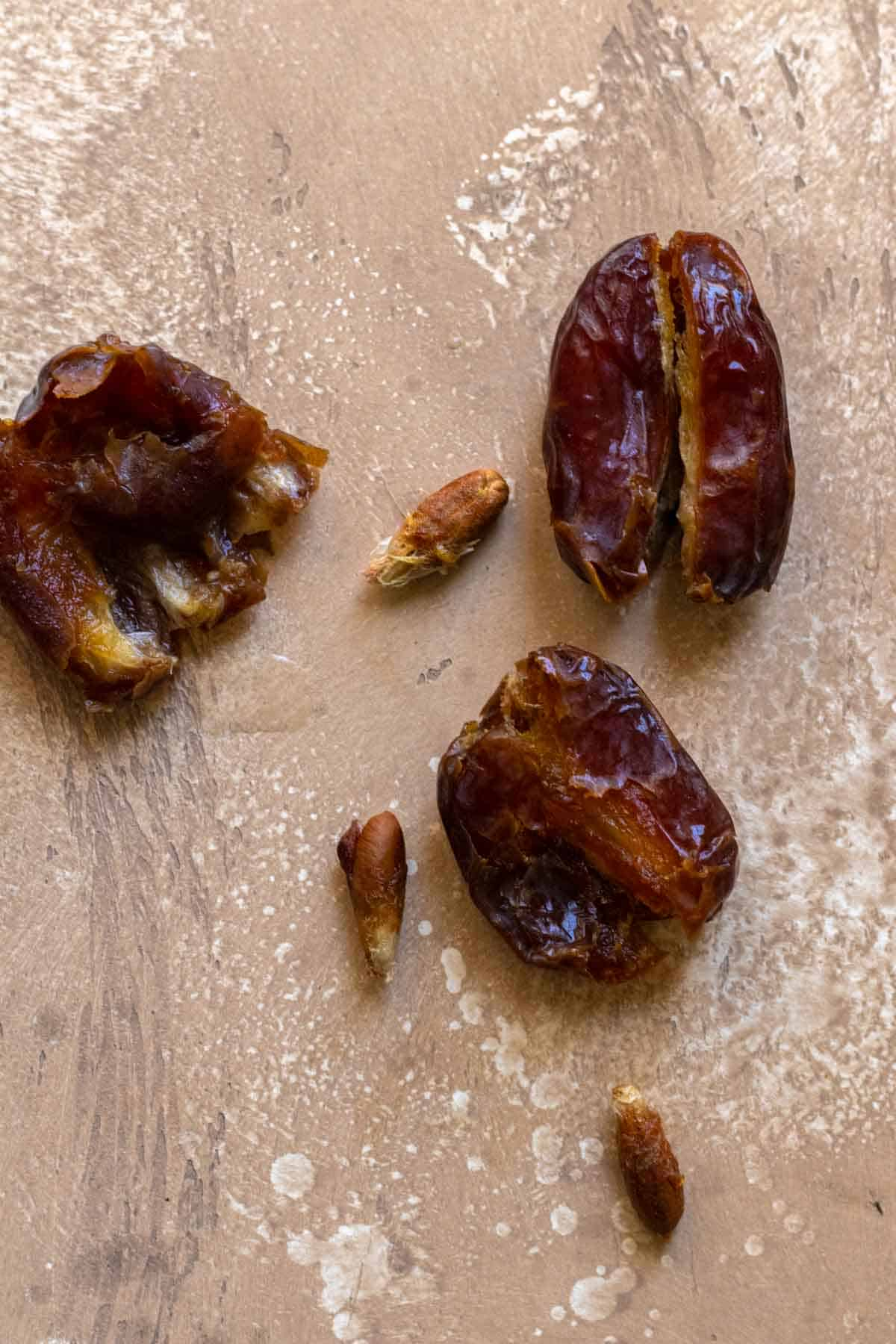 3 medjool dates split down the middle with their pits removed.