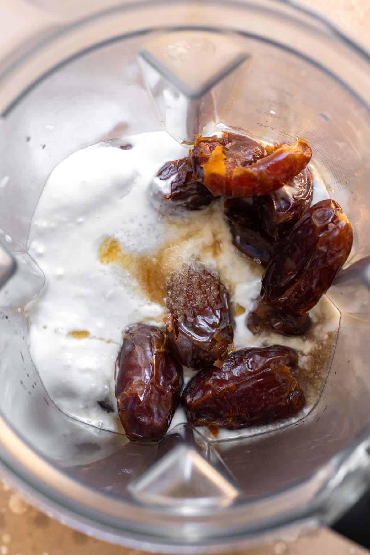 Medjool dates, coconut cream, maple syrup, and kosher salt in Vitamix blender before blending.