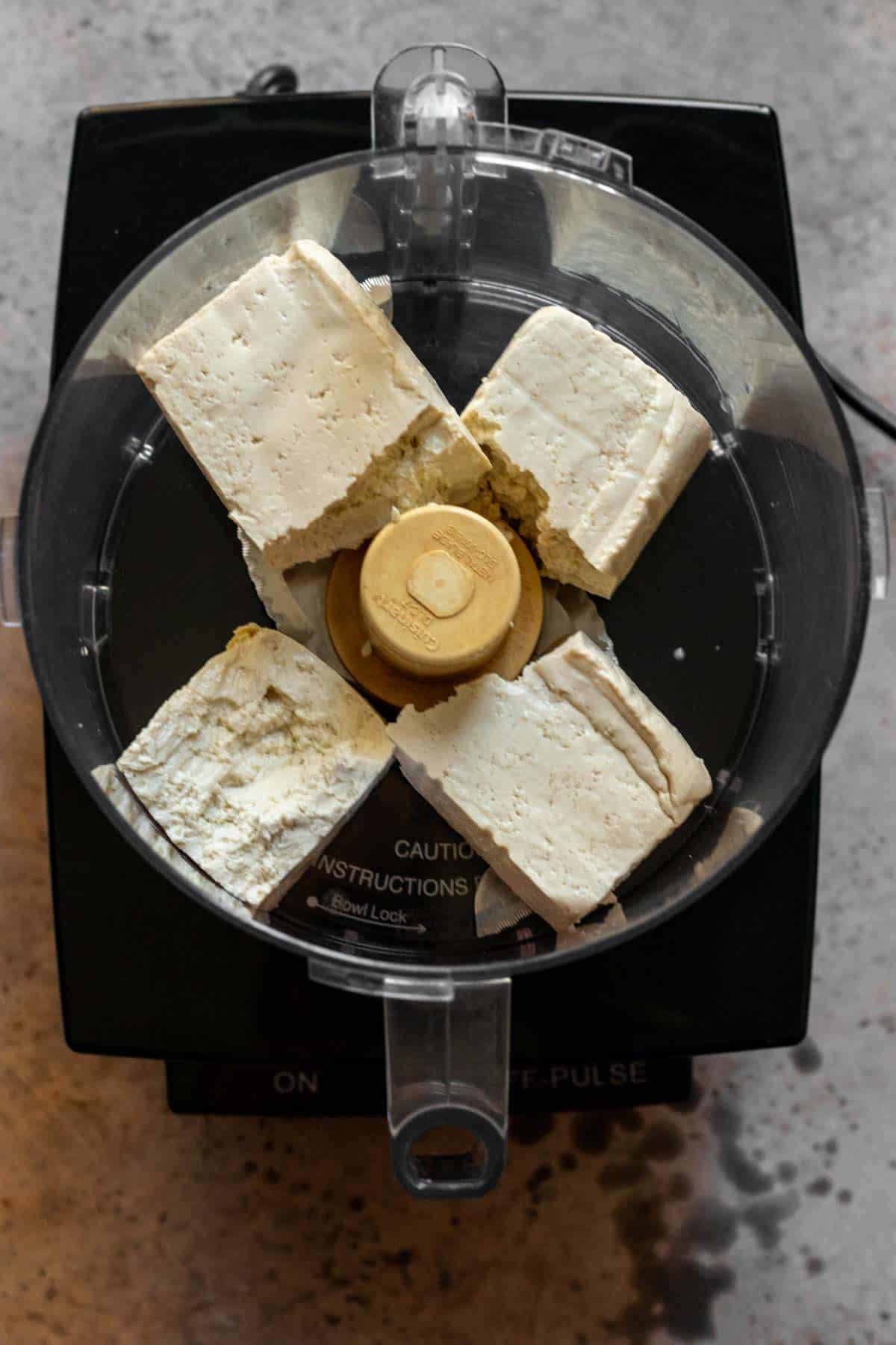 4 pieces of tofu in food processor.