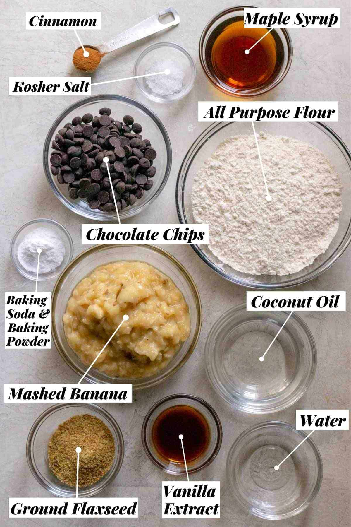 Ingredients for banana bread measured out into individual bowls and labeled.