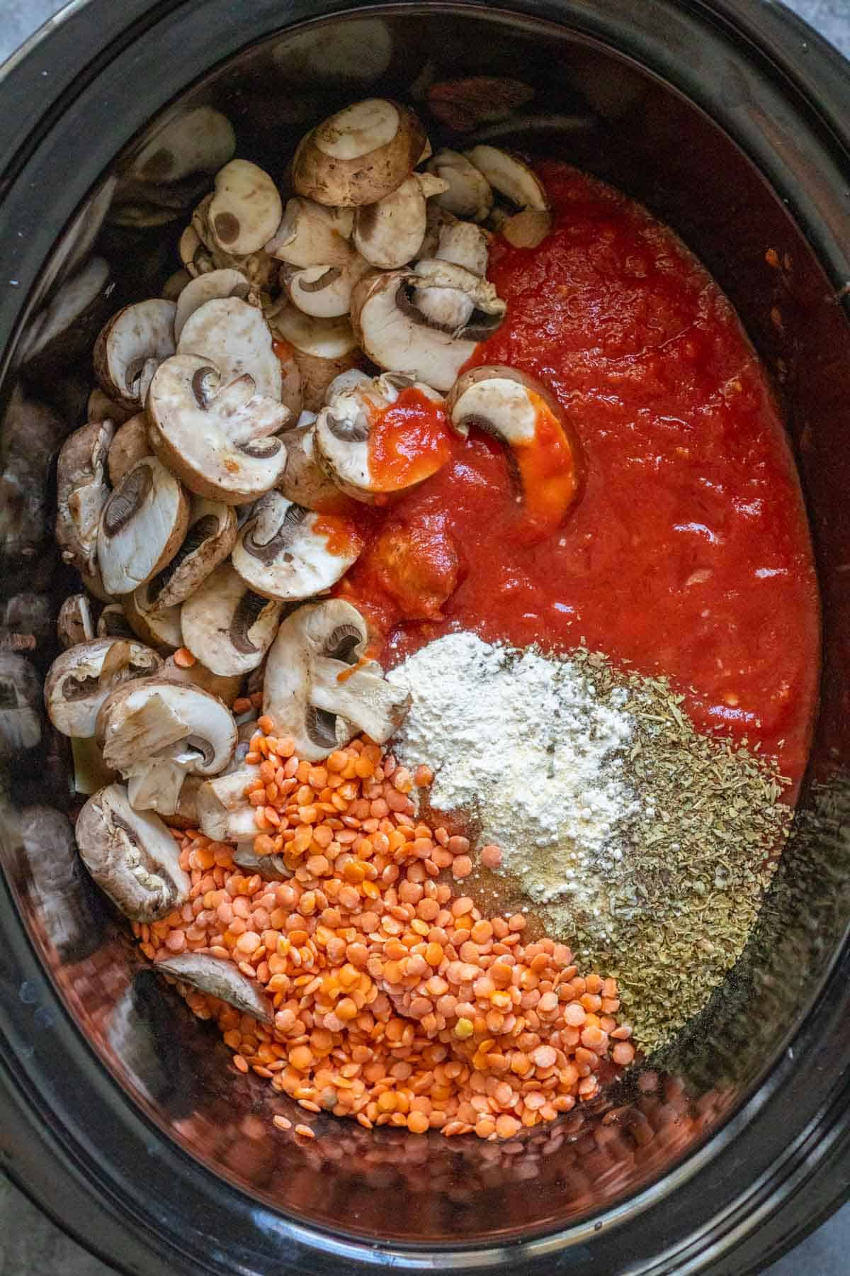 Soup Ingredients layered in crockpot.