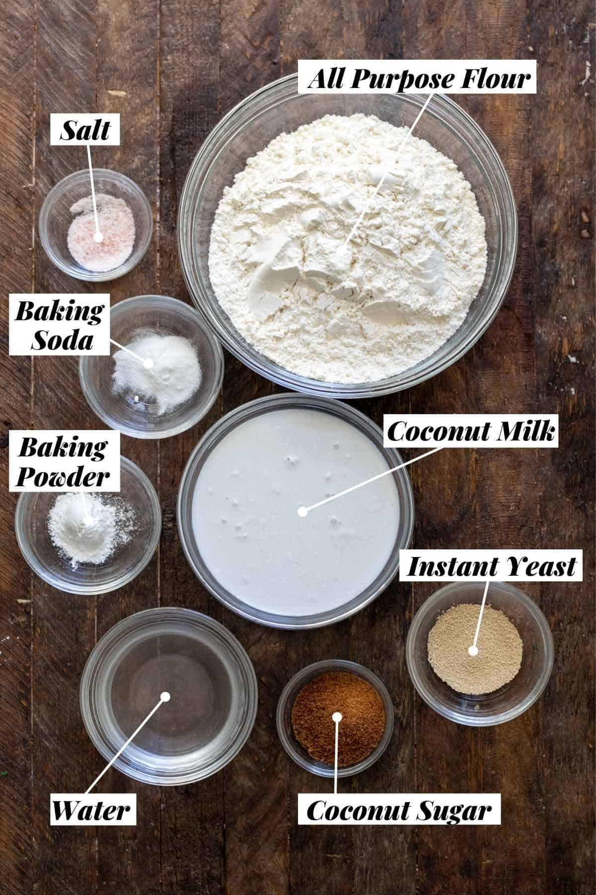 Ingredients needed for naan measured out into individual bowls and labeled.