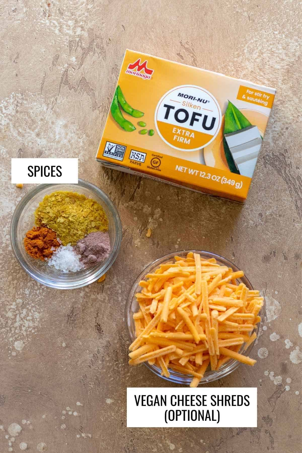 Ingredients needed for a silken tofu scramble on beige background with labels.