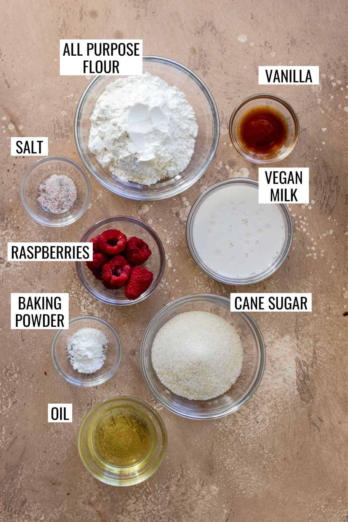 Cake ingredients measured and labeled in individual bowls.