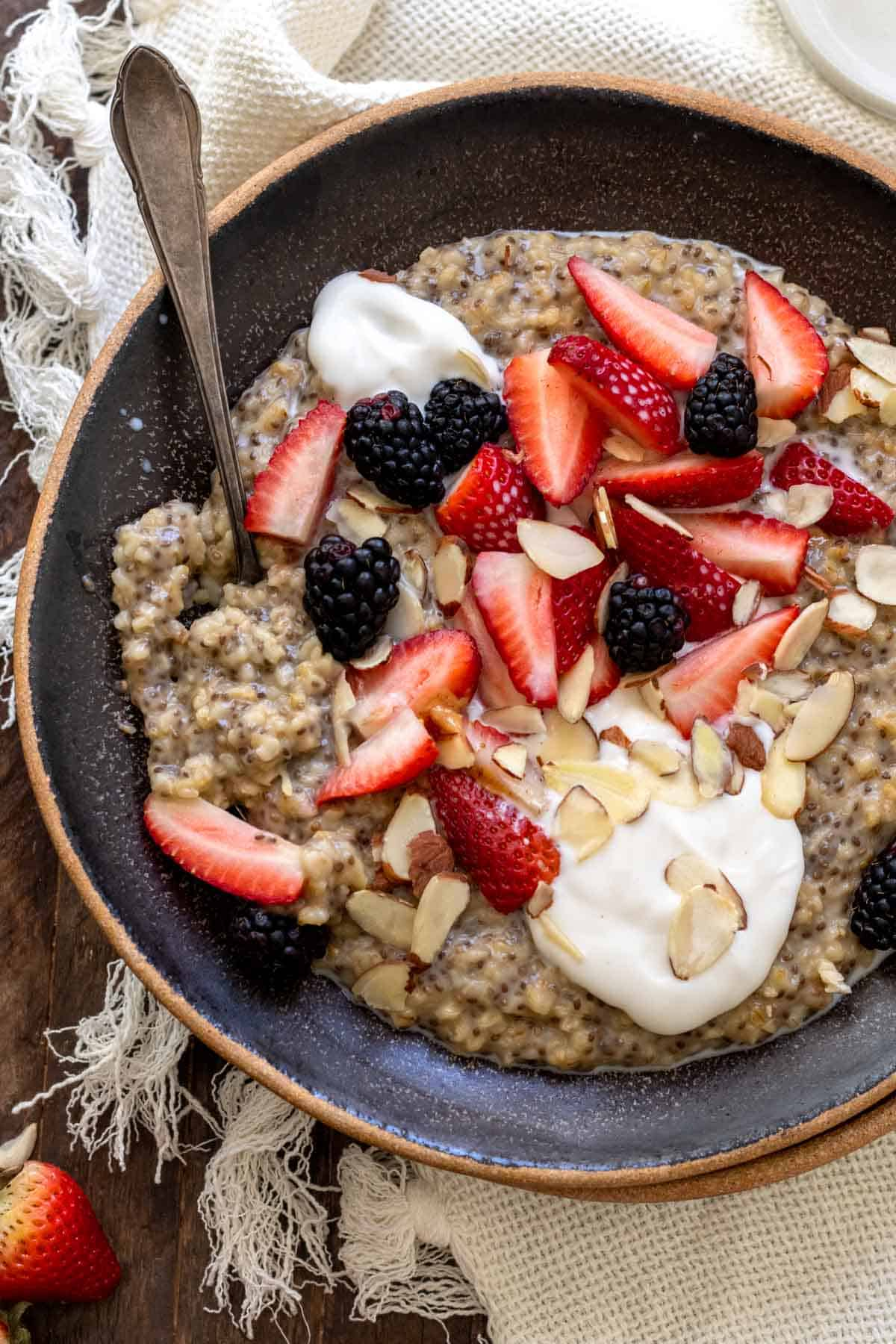 Single serving oatmeal topped with fresh berries and yogurt.
