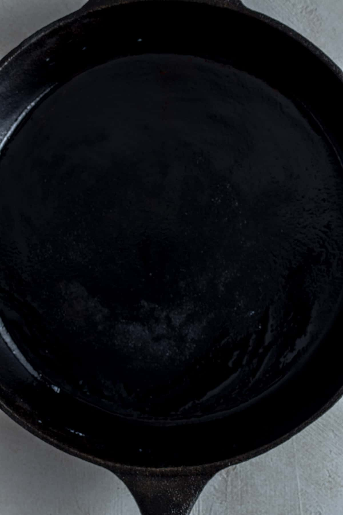Oiled cast iron skillet heated nice and hot.
