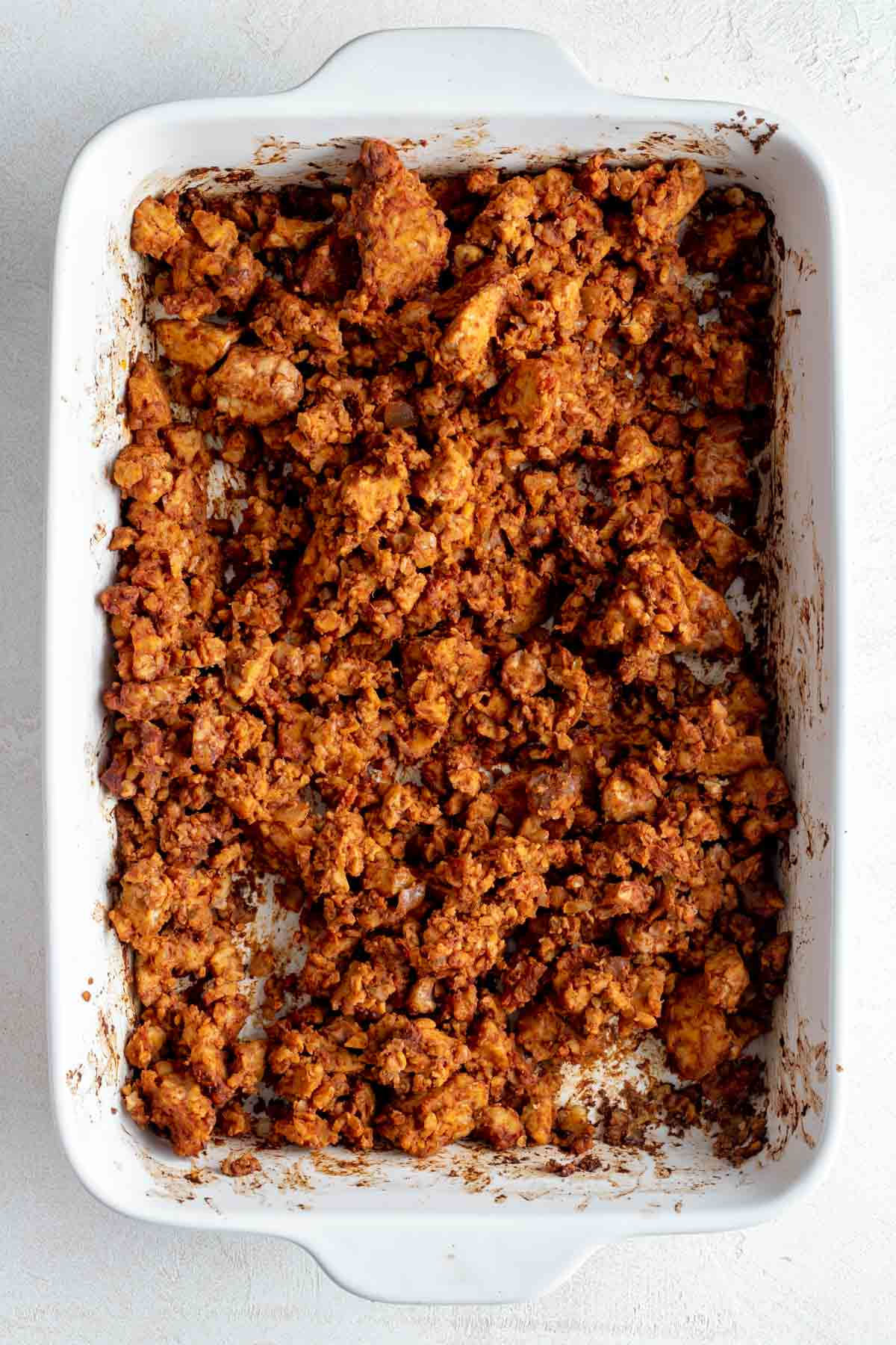 Baked taco meat in white casserole dish.
