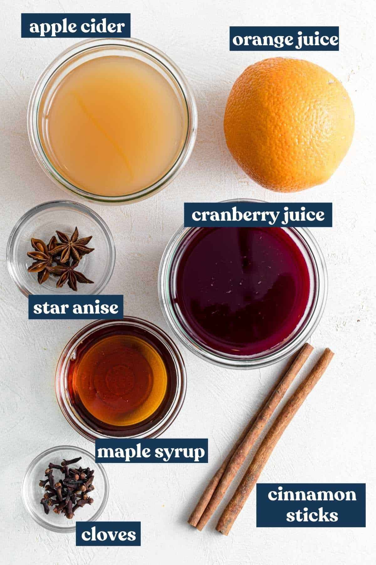 Ingredients necessary for non-alcoholic mulled wine recipe with labels.