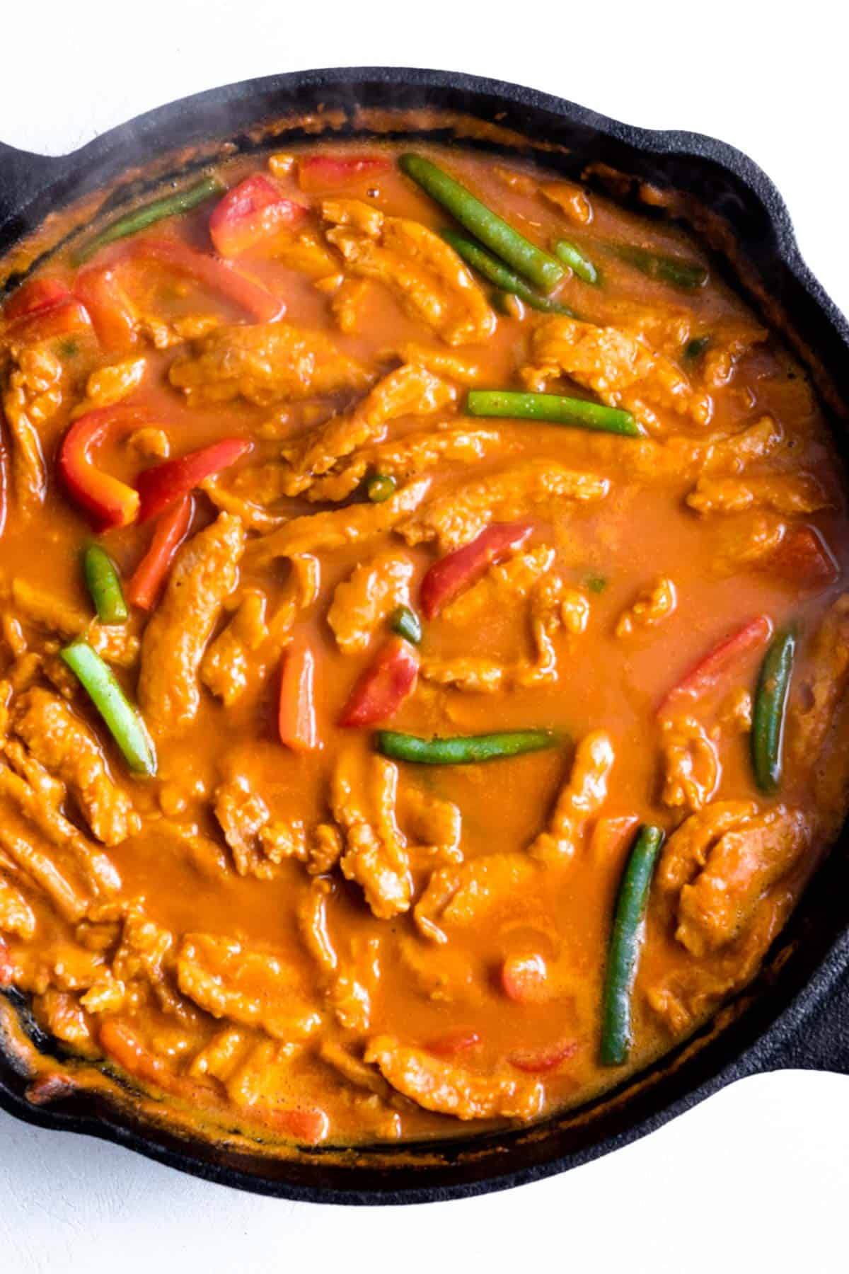 Green beans and bell pepper added into curry.